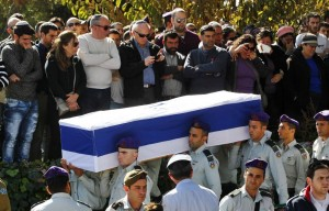 Israeli soldiers carry the flag-draped coffin of Captain Yochai Kalangel during his funeral at Mount Herzl military cemetery in Jerusalem